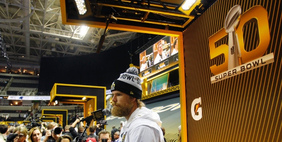 Feb 1, 2016; San Jose, CA, USA; Carolina Panthers tight end Greg Olsen is interviewed during Super Bowl 50 Opening Night media day at SAP Center. Mandatory Credit: Jerry Lai-USA TODAY Sports - RTX250F9