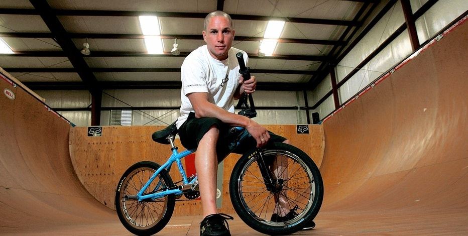 In a Friday, June 24, 2005 file photo, X-Games athlete Dave Mirra poses in the half-pipe at his training facility in Greenville, N.C.