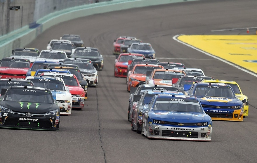 NASCAR Xfinity Series drivers Kyle Larson (42) and Kyle Busch (54) lead the field on a restart during the Ford Ecoboost 300 at Homestead-Miami Speedway.