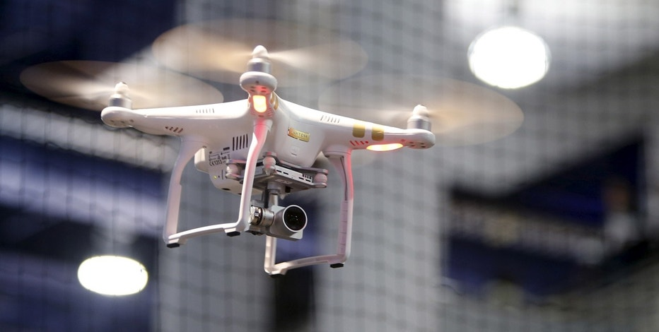 A DJI Phantom 3 Professional drone with 4K video flies in a drone cage during the 2016 CES trade show in Las Vegas, Nevada January 8, 2016.