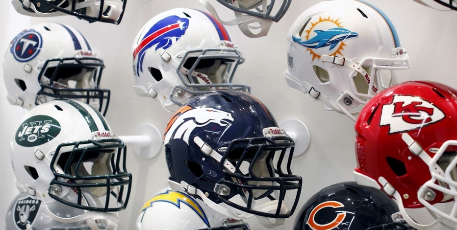 NFL helmets on display