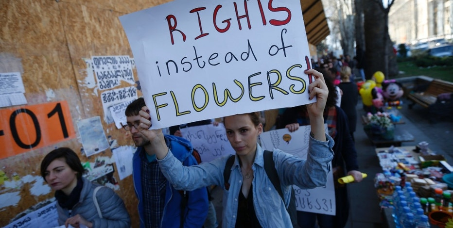 People march on the street to mark the International Women's Day in Tbilisi, Georgia, March 8, 2016. REUTERS/David Mdzinarishvili - RTS9T87