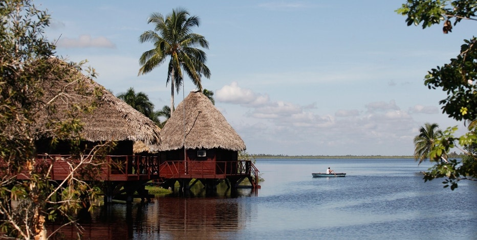 A man rows a boat at the Guama tourism resort in the Zapata Swamp Biosphere Reserve Park south of the Matanzas province in central Cuba.