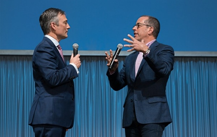Jerry Seinfeld appears on the auction stage with Gooding & Co. President David Gooding.