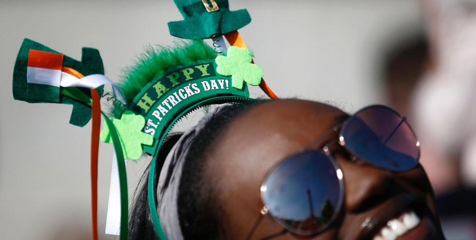 A woman joins in the celebrations during a St. Patrick's Day party and concert in Trafalgar square in central London, Britain March 13, 2016.  REUTERS/Peter Nicholls - RTX28YEM