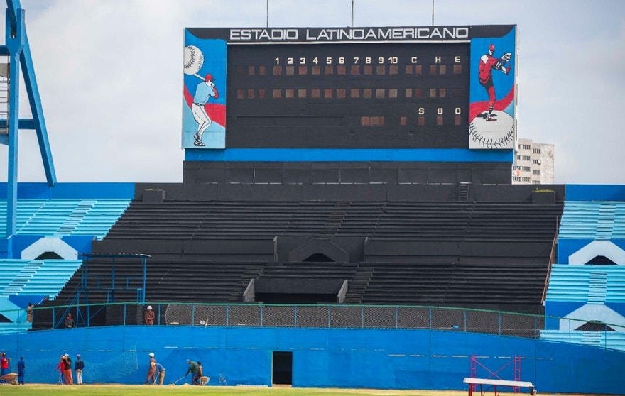 Workers work on the Latinoamericano Stadium baseball arena in Havana, Cuba, Friday, March 4, 2016. U.S. President Barack Obama plans to attend the Tampa Bay Rays' exhibition game at the arena on March 22 during his visit to Cuba.