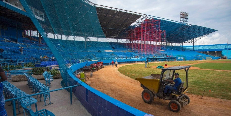 Workers work on the Latinoamericano Stadium baseball arena in Havana, Cuba, Friday, March 4, 2016. U.S. President Barack Obama plans to attend the Tampa Bay Rays' exhibition game at the arena in Cuba on March 22 during his visit.