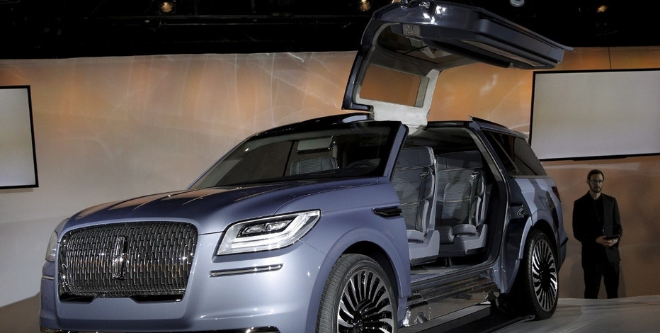 A Lincoln Navigator concept vehicle is displayed on the eve of the 2016 New York International Auto Show in New York City March 21, 2016. REUTERS/Brendan McDermid   - RTSBSYD