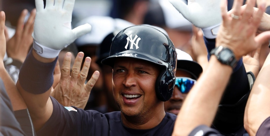 Mar 3, 2016; Tampa, FL, USA; New York Yankees designated hitter Alex Rodriguez (13) celebrates with high fives as he walks through the dugout after hitting a two run home run against the Philadelphia Phillies during the first inning at George M. Steinbrenner Field. Mandatory Credit: Butch Dill-USA TODAY Sports - RTS979A