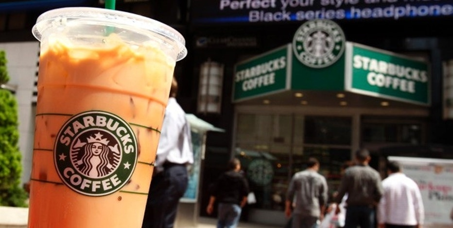 A Starbucks drink is seen on a table in New York's Times Square April 21, 2010.  REUTERS/Shannon Stapleton (UNITED STATES - Tags: FOOD BUSINESS)