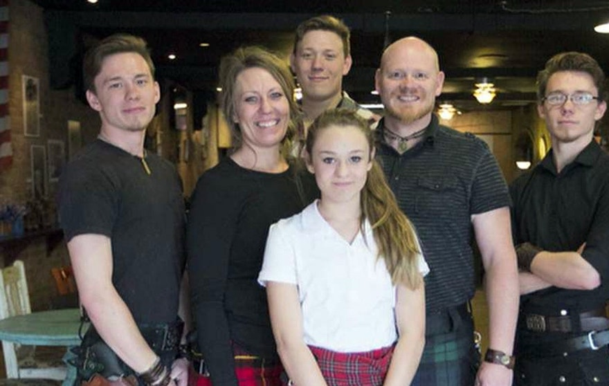 Monika and Tony Siebers, the married co-owners of Utah's Sea Bears Ogden Fish House, and their four children wear kilts around their waists and guns on their hips.