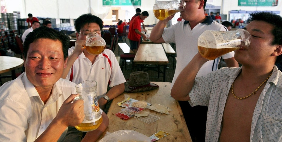 Men drink beer during a beer festival in Qingdao, Shandong province.