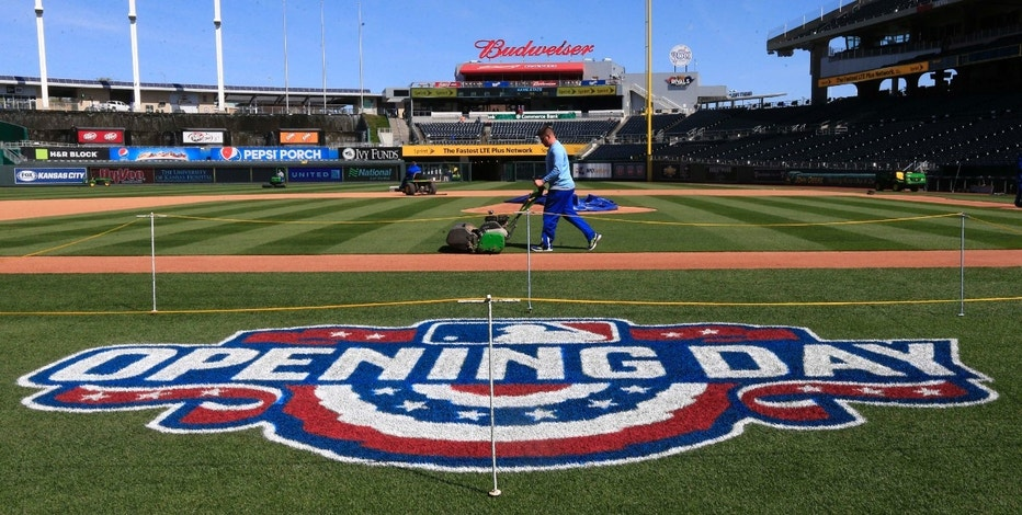 Grounds crew members prepare for the field at Kauffman Stadium in Kansas City, Mo., Saturday, April 2, 2016, for Sunday's opening day baseball game between the New York Mets and Kansas City Royals.