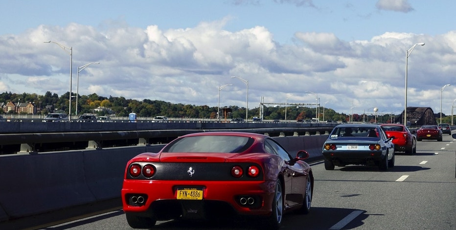 People drive Ferrari cars on a highway during an annual fall drive, organized by a Ferrari club, in Fishkill, New York October 18, 2015.