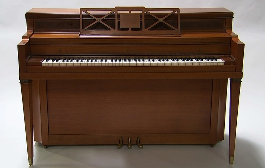 """This April 5, 2016 image taken from video shows a piano owned by singer Lady Gaga in Culver City, Calif. Julien's Auctions is offering the instrument in its """"Music Icons"""" memorabilia sale at the Hard Rock Cafe New York on May 21."""