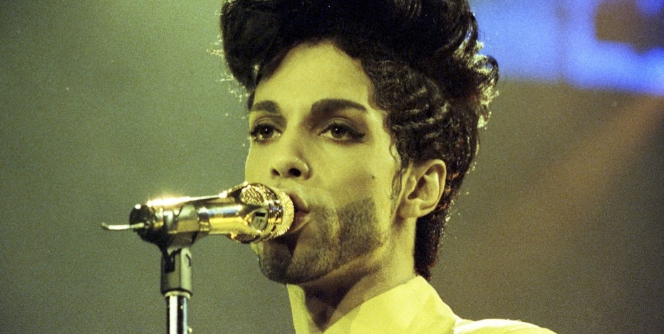 Prince performs during his 'Diamonds and Pearls Tour' at the Earl's Court Arena in London, Britain, June 15, 1992.