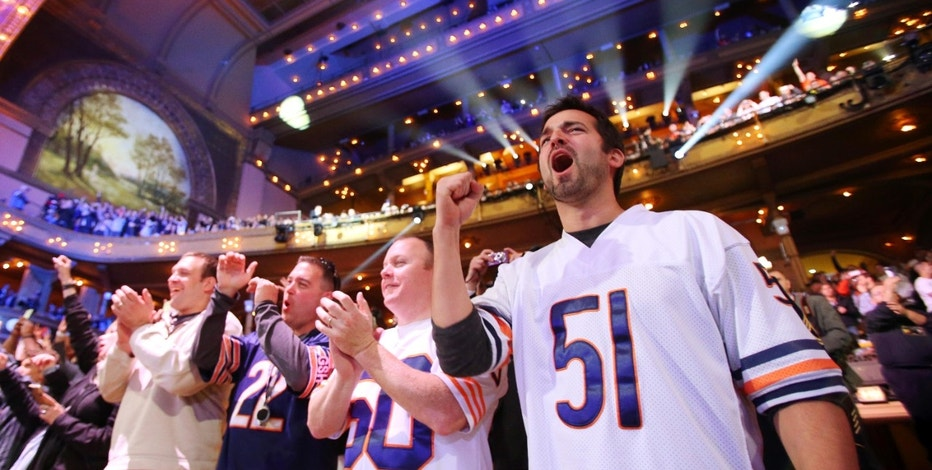Apr 30, 2015; Chicago, IL, USA; Chicago Bears fans cheer after Kevin White (West Virginia) is selected as the number seven overall pick to the Chicago Beras in the first round of the 2015 NFL Draft at the Auditorium Theatre of Roosevelt University. Mandatory Credit: Jerry Lai-USA TODAY Sports - RTX1B1N7