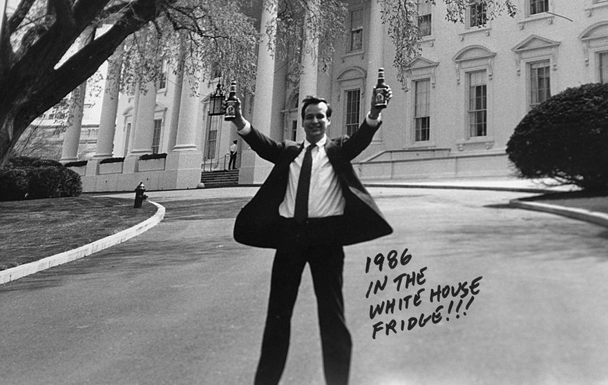 Boston Beer Company Founder Jim Koch at the White House in 1986, holding bottles of Samuel Adams beer.