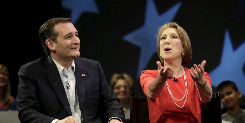Republican U.S. presidential candidate Ted Cruz is joined by former Republican presidential candidate and recently announced supporter Carly Fiorina at a Cruz town hall event at the Faith Assembly of God in Orlando, Florida U.S. March 11, 2016. U.S. Republican presidential candidate Ted Cruz is expected to announce former business executive Carly Fiorina will be his vice presidential running mate if he wins the party's nomination, ABC News affiliate WMUR reported, citing unnamed sources. REUTERS/Kevin Kolczynski/File Photo      TPX IMAGES OF THE DAY      - RTX2BXI1