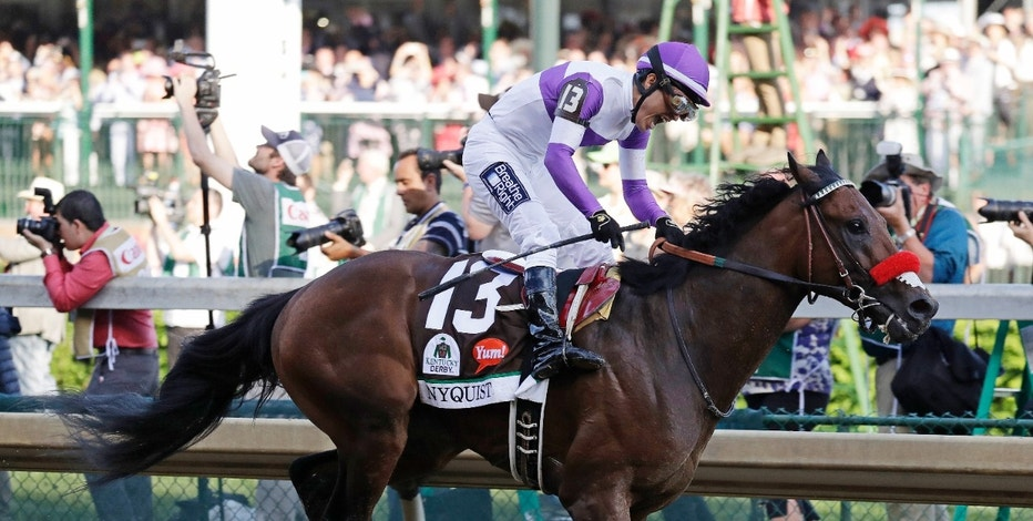 CORRECTS SPELLING OF LAST NAME TO GUTIERREZ FROM GUITIERREZ - Mario Gutierrez celebrates after riding Nyquist to victory during the 142nd running of the Kentucky Derby horse race at Churchill Downs, Saturday, May 7, 2016, in Louisville, Ky. (AP Photo/Garry Jones)