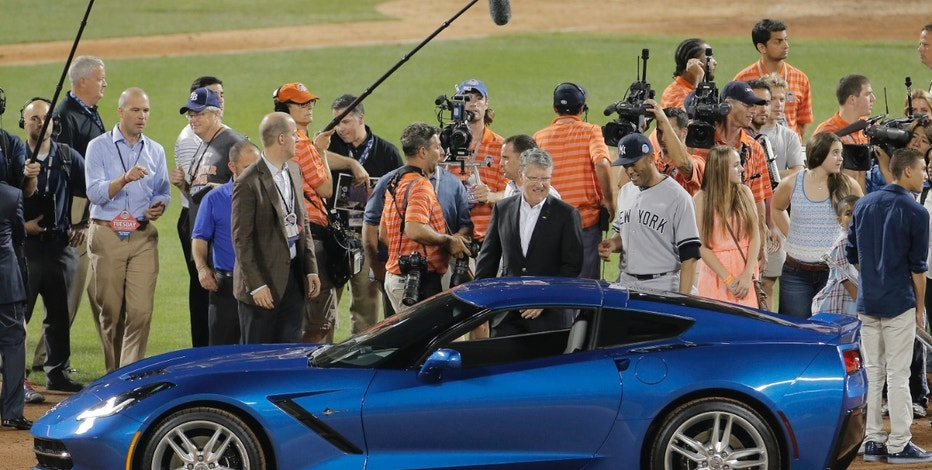 All-Star MVP Mariano Rivera (center, R) of the New York Yankees is presented a new Chevrolet Corvette Stingray after after being named MVP of the 2013 All-Star Game following Major League Baseball's All-Star Game in New York, July 16, 2013.