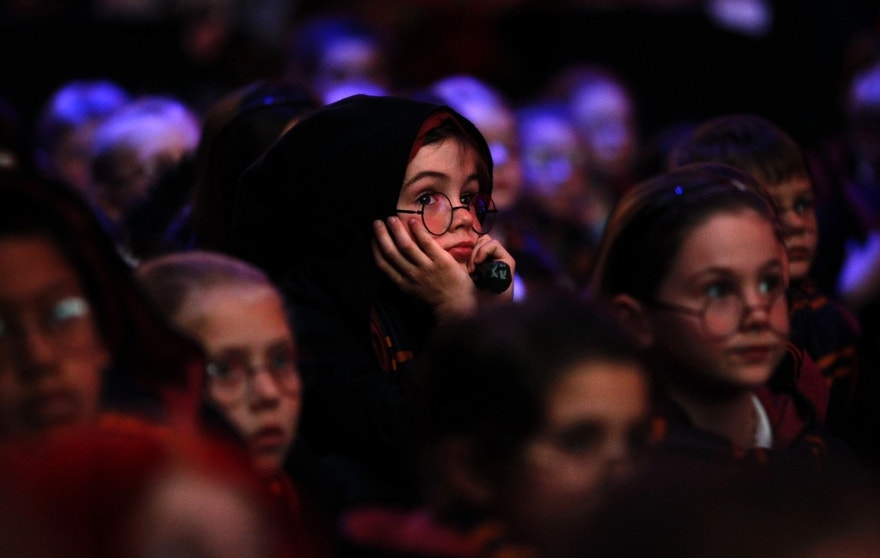 Children dressed as J.K. Rowling's famous character Harry Potter watch a presentation at the launch of the Harry Potter exhibition in Sydney's Powerhouse Museum.