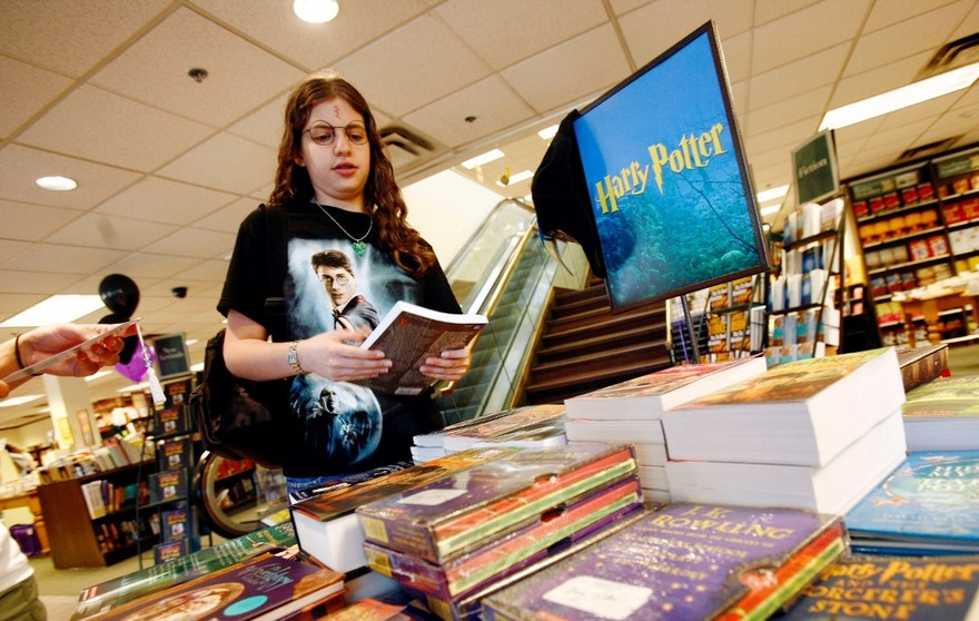 """Harry Potter fan Mallory Levy looks at Harry Potter novels at the Barnes & Noble bookstore before the midnight release of """"Harry Potter and the Deathly Hallows."""""""