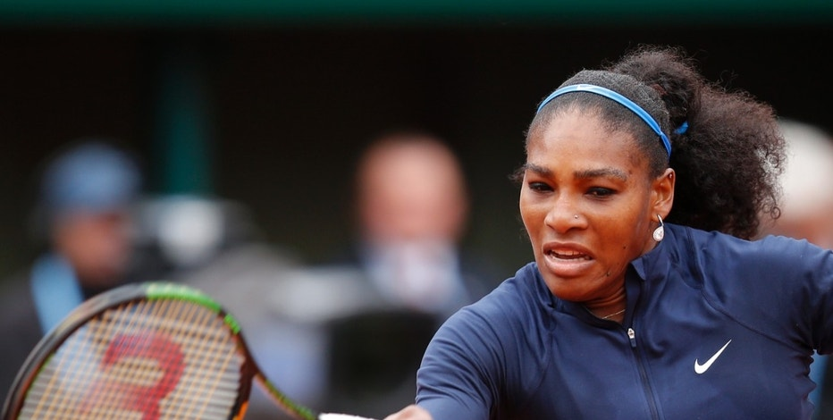 Serena Williams of the U.S. returns the ball to  Spain's Garbine Muguruza during their final match of the French Open tennis tournament at the Roland Garros stadium, Saturday, June 4, 2016 in Paris. (AP Photo/Michel Euler)