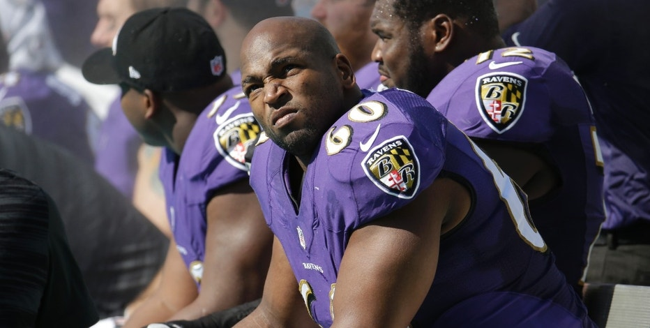 FILE - In this Dec. 7, 2014, file photo, Baltimore Ravens offensive tackle Eugene Monroe looks up from the sidelines during the first half of an NFL football game against the Miami Dolphins in Miami Gardens, Fla. Monroe was released by the Ravens on Wednesday, June 15, 2016. (AP Photo/Lynne Sladky, File)