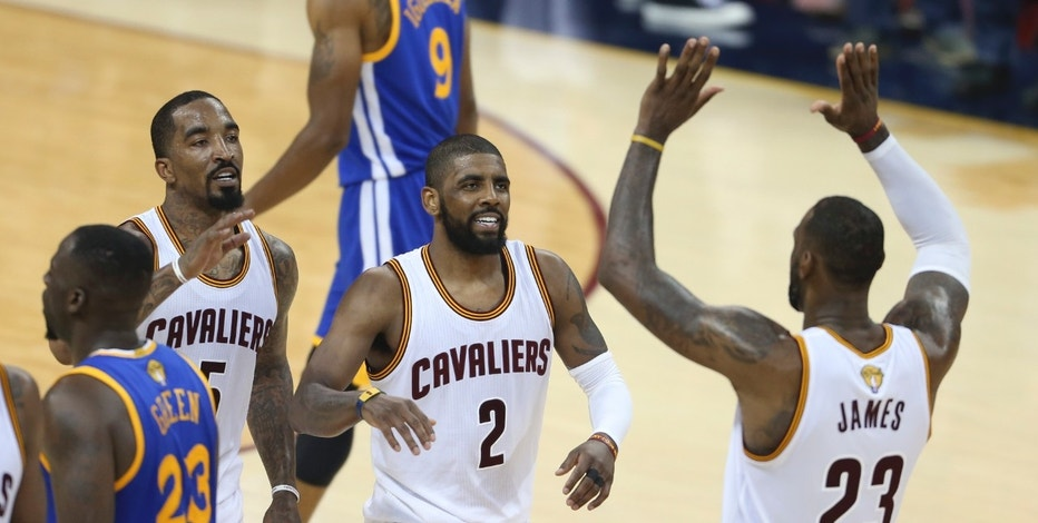 Cleveland Cavaliers forward LeBron James (23) celebrates with Kyrie Irving (2) and J.R. Smith (5) against the Golden State Warriors during the first half of Game 6 of basketball's NBA Finals in Cleveland, Thursday, June 16, 2016. (AP Photo/Ron Schwane)