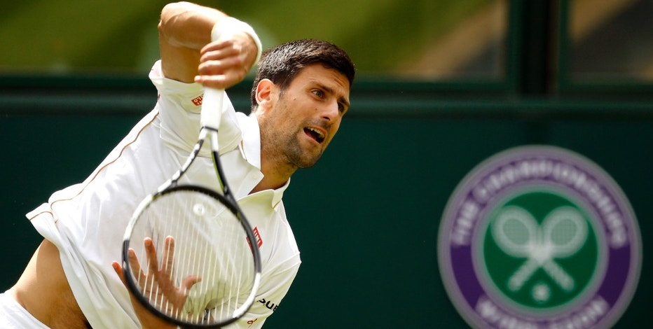 Novak Djokovic of Serbia serves to Jamie Ward of Britain during day one of the Wimbledon Tennis Championships in London, Monday, June 27, 2016. (AP Photo/Alastair Grant)
