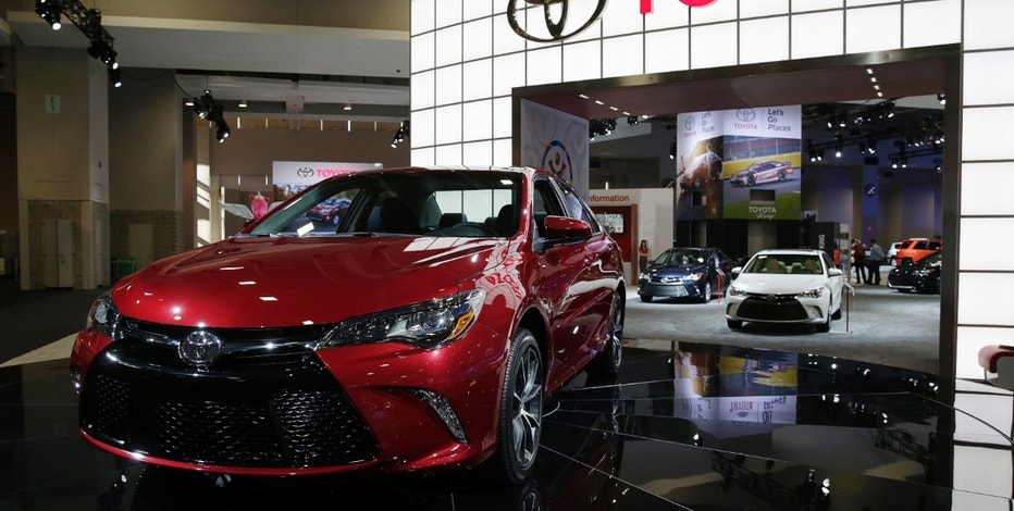 A 2015 Toyota Camry (L) is seen at the press day for the Washington Auto Show in Washington January 22, 2015.