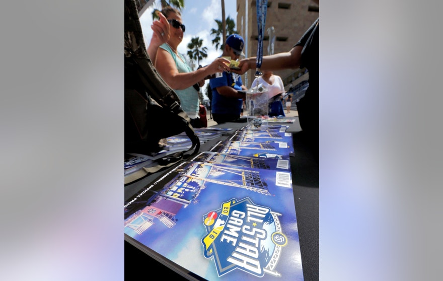 Fans purchase programs outside Petco Park prior to the MLB All-Star baseball Home Run Derby, Monday, July 11, 2016, in San Diego.
