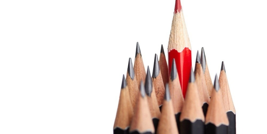 Red pencil standing out from crowd of plenty identical black fellows on white backgroung. Leadership uniqueness independence initiative strategy dissent think different business success concept