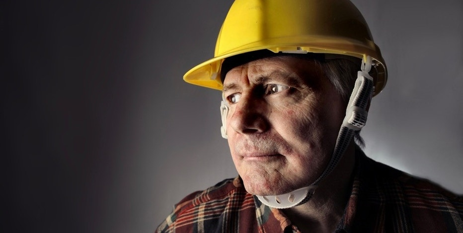 portrait of senior worker with an hardhat