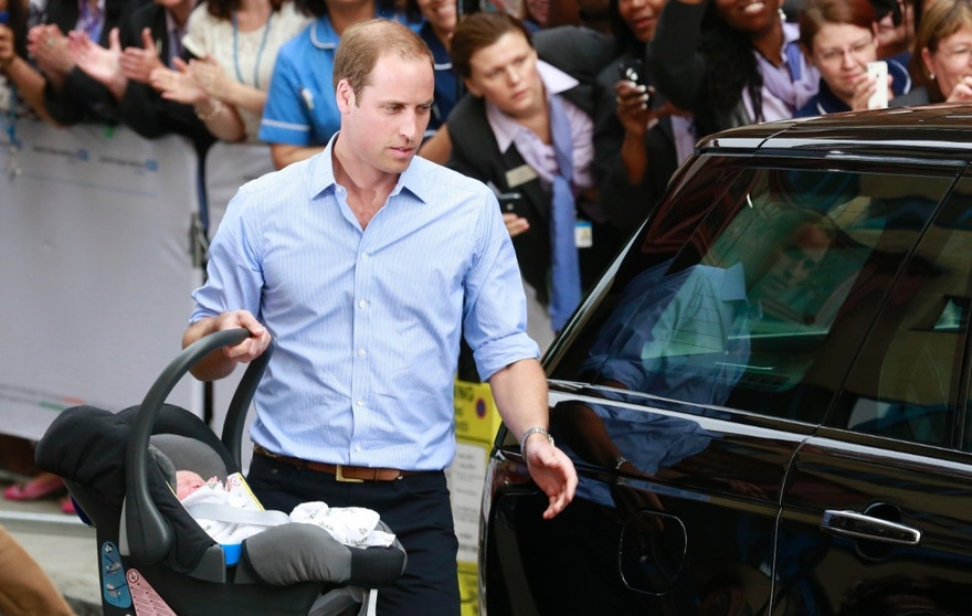 Britain's Prince William carries his baby son in a car seat, as he leaves the Lindo Wing of St Mary's Hospital with his wife Catherine, Duchess of Cambridge, in central London July 23, 2013.  Kate gave birth to the couple's first child, who is third in line to the British throne, on Monday afternoon, ending weeks of feverish anticipation about the arrival of the royal baby.  REUTERS/Cathal McNaughton  (BRITAIN - Tags: ROYALS ENTERTAINMENT HEALTH) - RTX11WG2