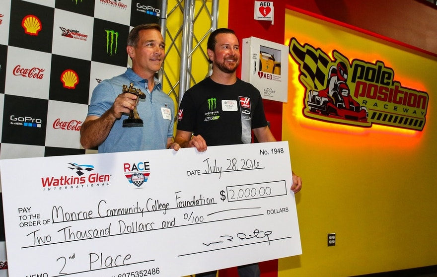 Xerox president Mike Zimmer (l) and NASCAR driver Kurt Busch (r) at Pole Position Raceway in Rochester, N.Y.