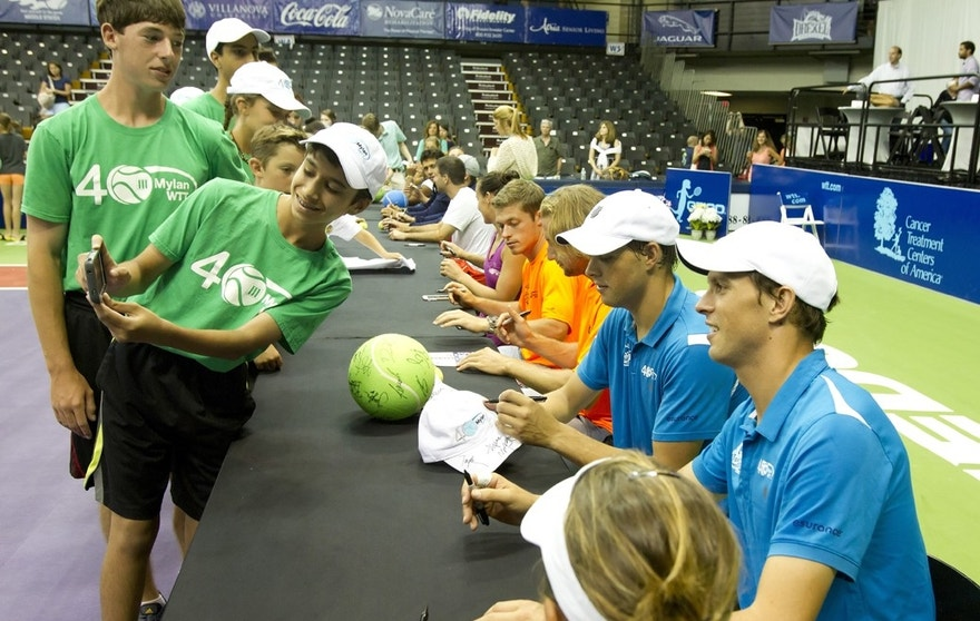 Bob and Mike Bryan sign autographs after a World TeamTennis match in 2015.