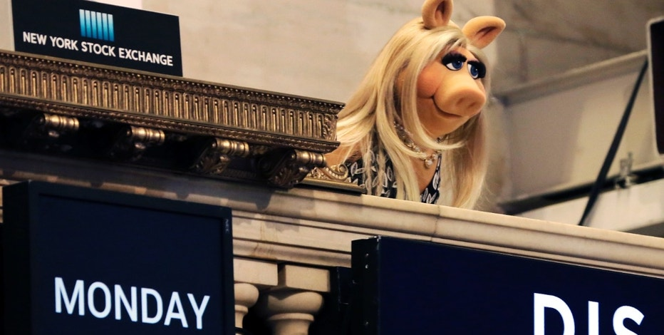 "FILE - In this Monday, Feb. 1, 2016, file photo, Miss Piggy overlooks the New York Stock Exchange trading floor after ringing the opening bell to highlight Disney's ""The Muppets"" television show. Walt Disney reports financial results Tuesday, Aug. 9, 2016. (AP Photo/Richard Drew, File)"