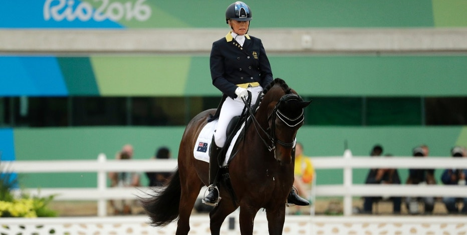 Australia's Mary Hanna, riding Boogie Woogie 6, competes in the equestrian dressage competition at the 2016 Summer Olympics in Rio de Janeiro, Brazil, Wednesday, Aug. 10, 2016. (AP Photo/John Locher)