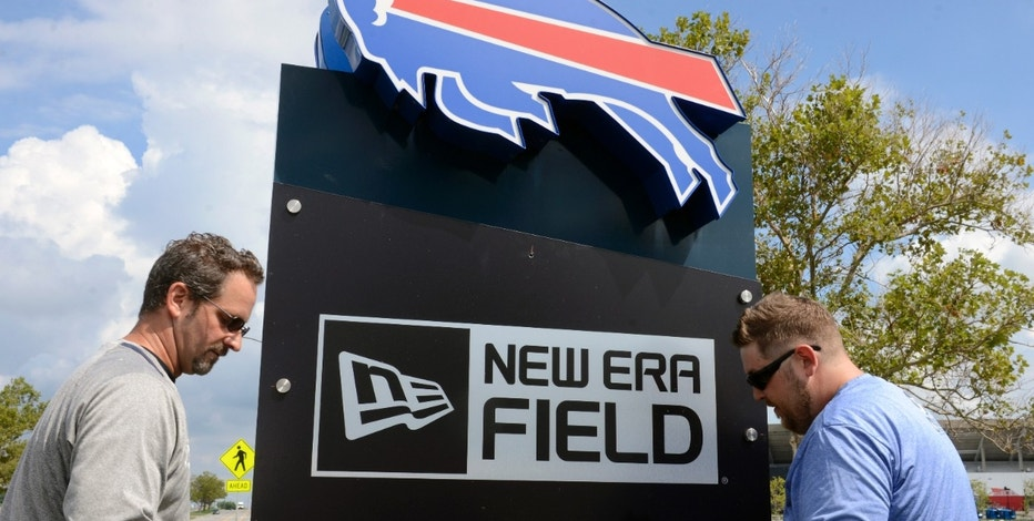 David Breitenbecker, left, and Doug Krell, sign technicians for the VSP Graphics Group, attach bolts to a sign at One Bills Drive after it was announced the team will rename the stadium where the NFL Buffalo Bills play to New Era Field,  Thursday, Aug. 18, 2016, in Orchard Park, N.Y. (AP Photo/Gary Wiepert)