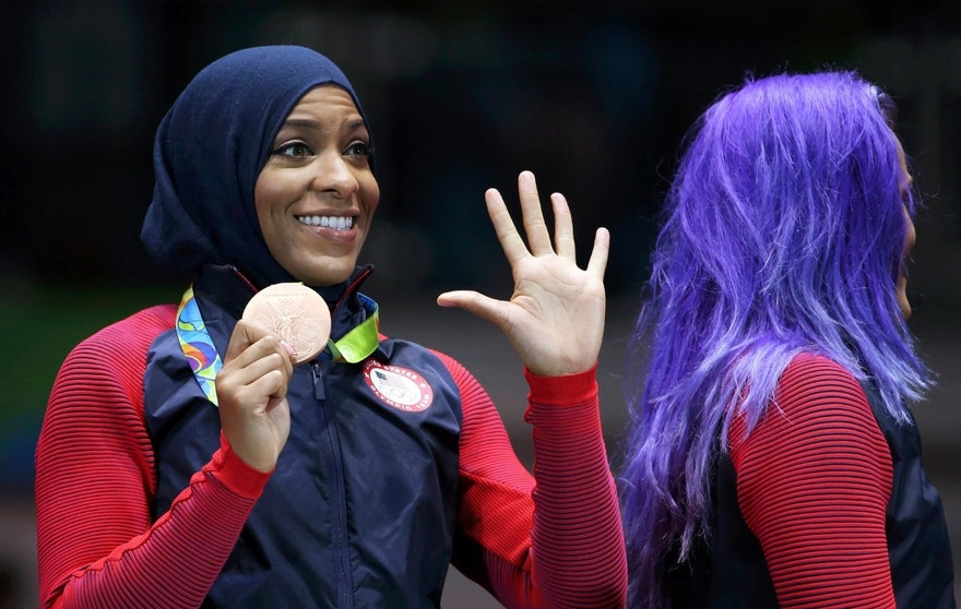 Ibtihaj Muhammad (USA) of USA celebrates winning the bronze medal in Rio.