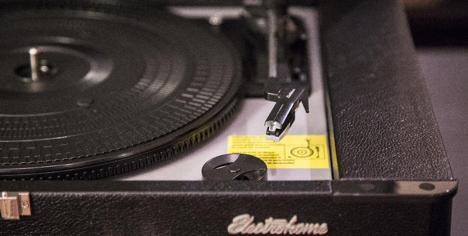 This Tuesday, Aug. 23, 2016, photo shows the Electrohome Archer Briefcase portable turntable, in Decatur, Ga. The unit has built-in speakers and a headphone jack if the user wants to listen in private. A USB port on the front lets the listener play music from a flash drive with song files. (AP Photo/ Ron Harris)