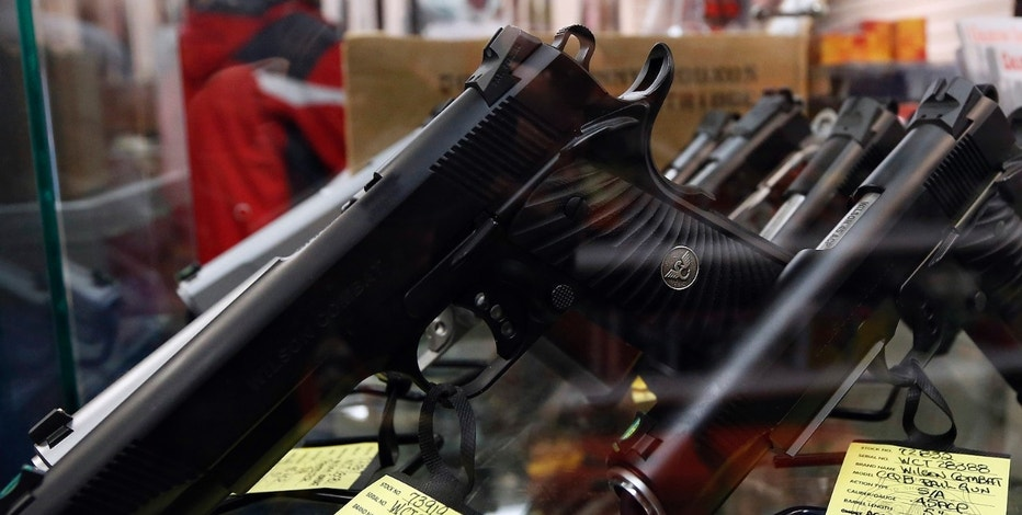 A display of 7-round .45 caliber handguns are seen at Coliseum Gun Traders Ltd. in Uniondale, New York January 16, 2013.