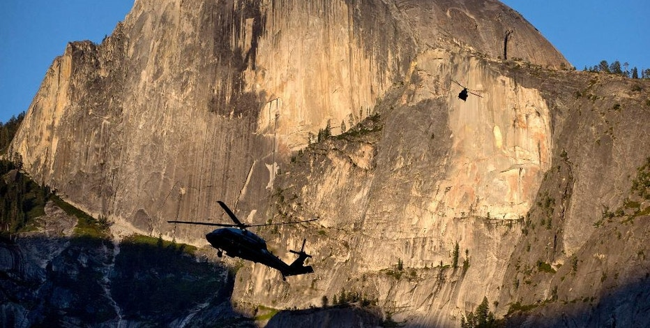 FILE - In this Friday, June 17, 2016, file photo, Marine One, foreground, carrying President Barack Obama, first lady Michelle Obama and daughters Malia Obama and Sasha Obama, and a support helicopter are silhouetted against the Half Dome rock formation at sunset as the first family arrives at Yosemite National Park, in Calif. In a new project with National Geographic, Obama becomes the first sitting U.S. president to project himself into virtual reality, in this case, a 360-degree representation of Yosemite National Park. The 11-minute VR video, narrated by Obama, is one part paean to the wonders of America's national parks and one part warning of the threat posed by climate change. (AP Photo/Jacquelyn Martin, File)