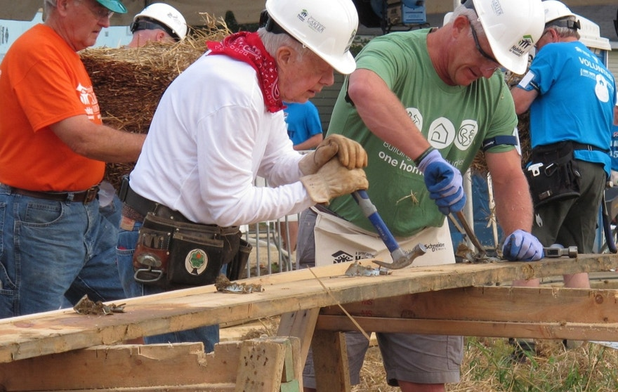 "Former President Jimmy Carter, center, works on a Habitat for Humanity construction project on Monday, Aug. 22, 2016 in Memphis, Tenn. On Monday, Carter said he thought he had just a few weeks to live during his battle with cancer a year ago. ""Now I feel pretty certain about my cure and the cancer being in remission, but the doctors are still keeping an eye on me,"" he said. (AP Photo/Adrian Sainz)"