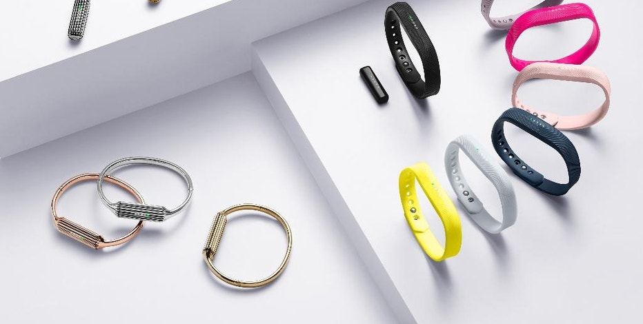 This image provided by Fitbit shows the Flex 2 family. Fitbit, the market leader in wearable devices, is updating two older devices, the 2013 Flex and the 2014 Charge, mostly to bring them in line with what newer devices and rivals offer. Besides tracking steps and sleep, the Flex 2 and the Charge 2 will remind people to take moving breaks throughout the day. That's coming to the Fitbit Blaze, too, through a software update. (Fitbit via AP)