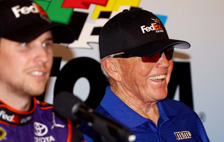 Feb 21, 2016; Daytona Beach, FL, USA; NASCAR Sprint Cup Series driver Denny Hamlin (11) and team owner Joe Gibbs during a press conference after winning the Daytona 500 at Daytona International Speedway. Mandatory Credit: Jasen Vinlove-USA TODAY Sports - RTX27YKN