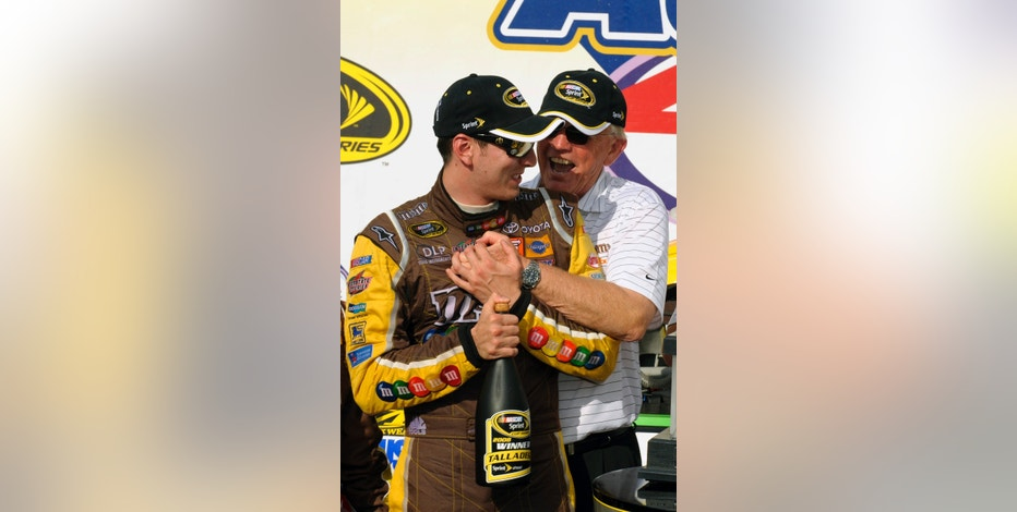 Kyle Busch (L) celebrates with team owner Joe Gibbs in victory lane after winning the NASCAR Sprint Cup Aaron's 499 Dream Weekend race at Talladega Superspeedway in Talladega, Alabama April 27, 2008. REUTERS/Robert LeSieur (UNITED STATES) - RTR1ZYSW