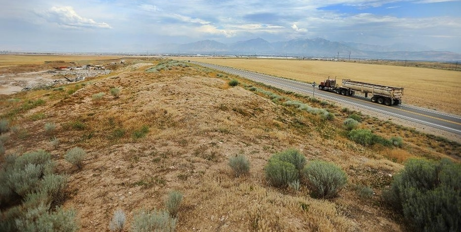 A Friday, Aug. 5, 2016 photo shows land in West Jordan, Utah, that may be purchased by FaceBook for a data center. The race between the small town of Los Lunas in New Mexico and the Salt Lake City suburb of West Jordan to entice a new Facebook data center with millions in tax breaks and subsidies is raising questions about public investments in a booming cloud-computing economy that typically brings few local jobs. (Scott G Winterton/Deseret News via AP)